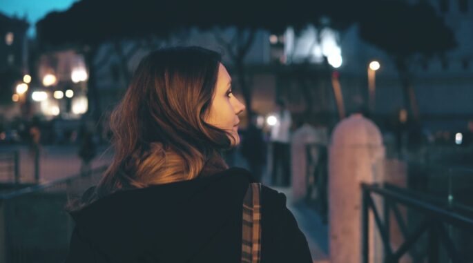 woman looking to the side at night