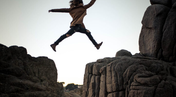 Woman jumping over the gap